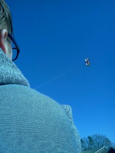 Looking over my son's shoulder at a kite in flight