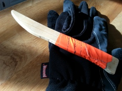 This is one of our dull practice knives.  We cut them out of wood and wrap the handles in orange duct tape.  Orange makes it clear to observers that we aren't trying to actually kill each other.  And it keeps them from getting lost easily.