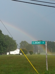 This rainbow popped up after a storm last week.  I sat at the stop sign, rolled down the window, and snapped this shot.