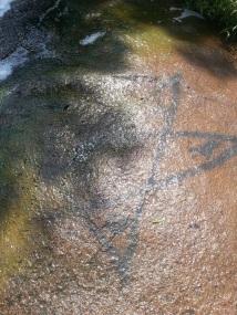 A pentagram of sorts scrawled on the rocks near the locks