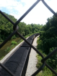 The view down from the walkway over the railroad tracks
