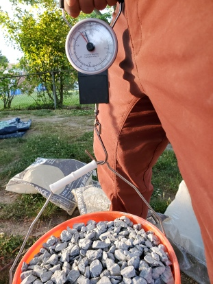 It takes about 1.6 bags of gravel to fill a bucket to 75 lbs