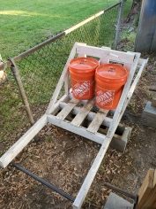 My redneck deadlift machine with with two weights loaded.
